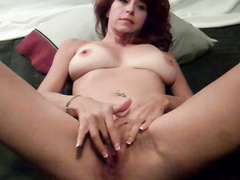 Sexy redhead milf rubbing cunt with vibrator in asshole